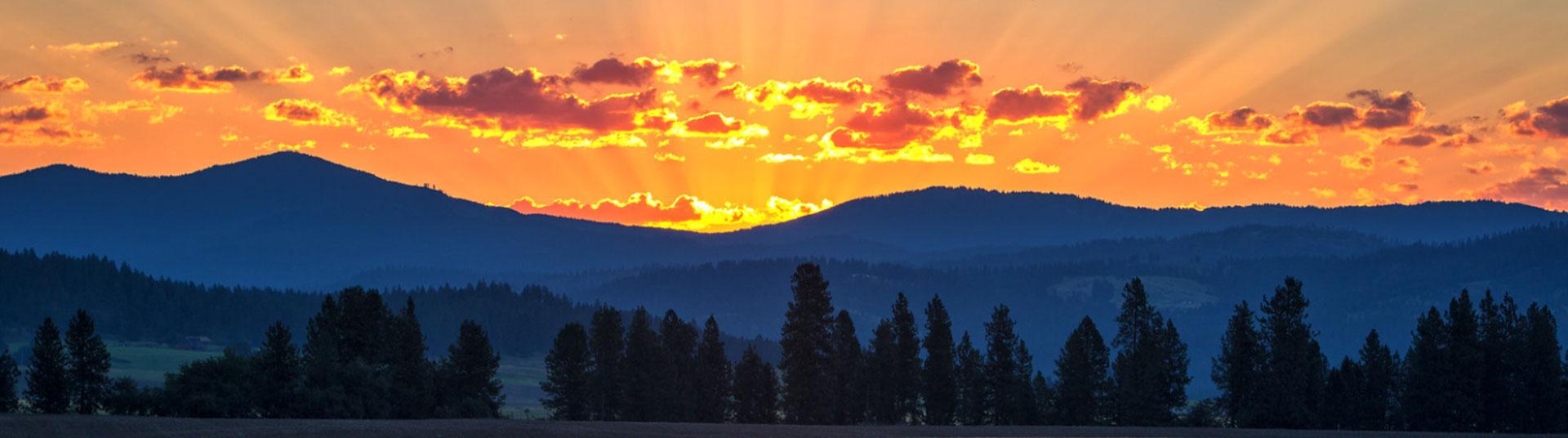 hero image - sunrise over mountains