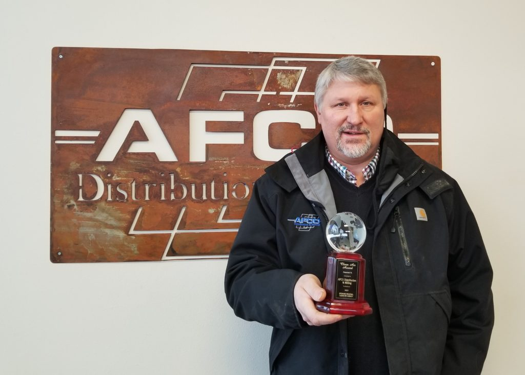 Lloyd Campbell, AFCO Director of Wholesale Distribution & Milling with the 2021 Clean Air Award.