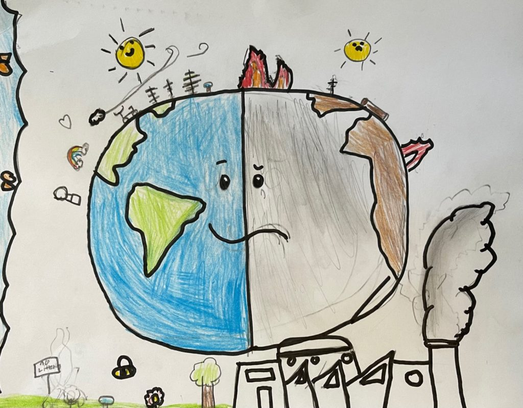 Kids drawing of the earth with clean air and pollution